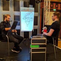 schnellzeichner daniel stieglitz kassel messezeichner iPad caricaturist live event karikaturist messe plentymarkets